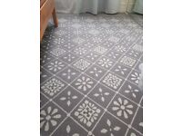 Grey rug with white flowers