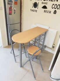 Breakfast bar and two stools