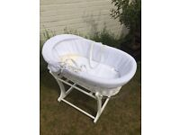 White wicker waffle moses basket with Mothercare white rocking stand and swaddling blankets