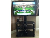 Tv and black glass unit