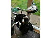 Left handed golf clubs with bag, tees and golf balls