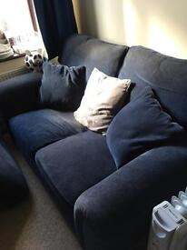 Two seater sofa and foot stall