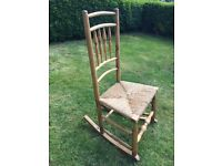 Antique oak small rush seated rocking chair 92 cms high, front of seat 46 cms wide
