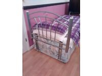 Single bed and brand new metal Headboard.