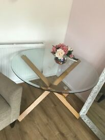Glass table with solid oak legs