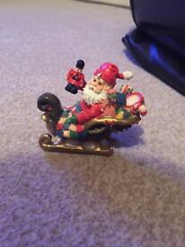 Santa in sleigh Christmas ornament