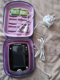 Purple Leapfrog Leappad2 with stylus, USB computer lead and plug, case, & 2 Leapster Explorer games