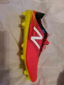 Never worn New Balance football boots