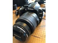 Nikon D3100 digital SLR Camera plus extra tele-macro lens, Lowepro case and Velbon Tripod.