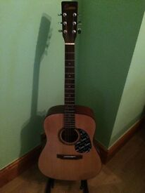 Electric acoustic Guitar full size in excellent condition quality case and learning book plus tuner.