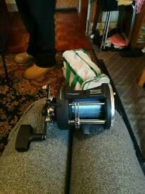 Fishing rod and reel beachcaster
