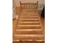 Single pine bed with clean mattress