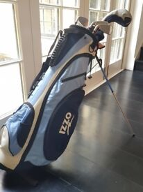 Full set of women's King Cobra clubs, carrying bag and travel bag. Barely used.
