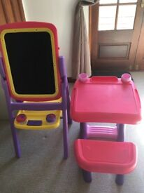 Childs plastic desk and a doubled sided easel and chalkboard stand