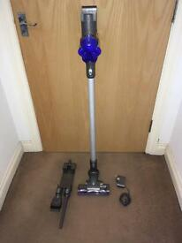 Dyson dc35 cordless handheld vacuum with charger and tools