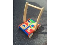 Childrens wooden bricks in trolley.