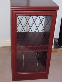 Glass fronted wooden unit