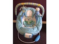 Musical and vibrating bouncy chair