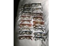 Vintage reading glasses from different decades.