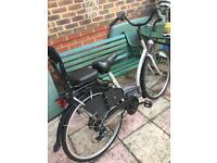 Dutch style city bike with child seat