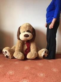 Large cuddly stuffed toy dog