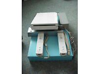 used twice, complete wii set ready to play all in original boxes, good condition, with 14 games WOW!