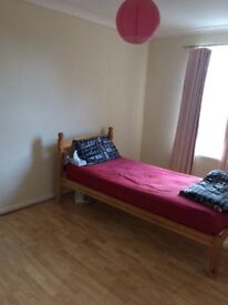 Double bed room to share in a three bedroom house.