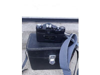 Zenit camera helios 44m with shoulder strap and carrying case