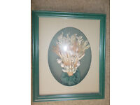 Green framed dried flower picture