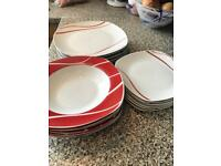 Dinner plates + salad plates + bowls set. Remaining pieces scratch and chip-free.
