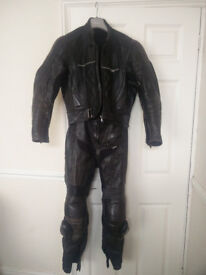 Two piece black real leather motorcycle suit (size S)