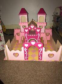 A lovely kids wooden castle/dolls house