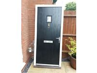 Composte Front Door. Black with all furniture and frame. 2 1/2 years old. Great condition. £250 ONO