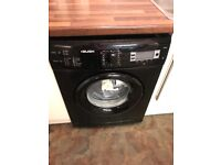 Black washing machine in good collection just selling as changing Couler in our kitchen to white