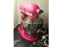 Kitchen Aid stand mixer in cranberry pink with attachments