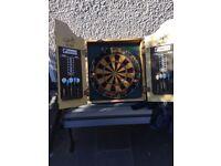 Phil Taylor dartboard in cabinet
