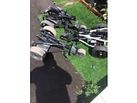 Three golf trolleys