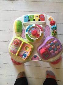 Vtech activity table for toddlers. Pink and white