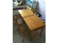 Vintage children's wooden double school desk. Hinged lids to storage compartments. Chairs included