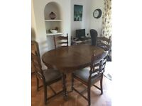 Extending oak dining table and 6 chairs set