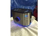Toaster by Tricity, blue light up 2 slice, stainless steel and black immaculate condition