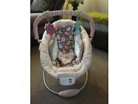 Pretty pink baby bouncer..vibration and musical options.
