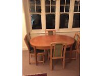 Solid oak extendable dining table and 4 comfortable chairs