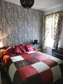 Double room in spacious terrace house shared amenities
