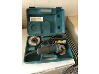 Makita angle grinder and Hilti box with various screws and bolts