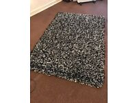 Thick black and white rug