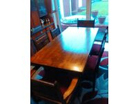 Antique solid oak dining table and chairs