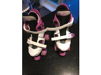Purple and white adjustable roller boots.
