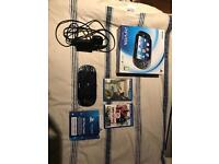 Mint condition PSVita wifi with games, 8GB SD card and plastic clear case