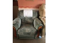 Free green armchair that has a foot rest . Smoke free home .used but in good condition